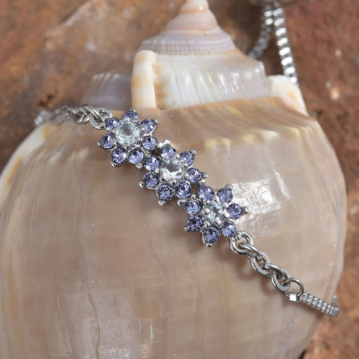 ee4cfc5f97dfc Details about Women's Blue Topaz Flower Slider Bolo Bracelet Made with  SWAROVSKI Tanzanite9.5